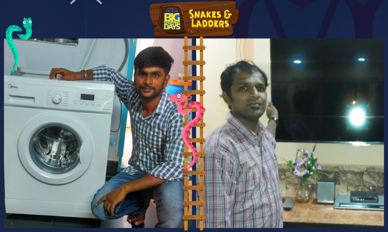 Flipkart customers Tej Kiran (L) and Russel Pereira (R) pose with the prizes they won by playing the Snakes & Ladders game
