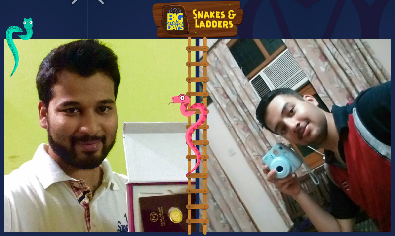 Flipkart customers Abdul Jaleel (L) and Mantavya Goyal (R) pose with the prizes they won in the Snakes & Ladders game
